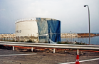 A liquid storage tank stands twisted at TEPCO's Fukushima Daiichi Nuclear Power Plant, part of the tsunami damage examined_1600x1067