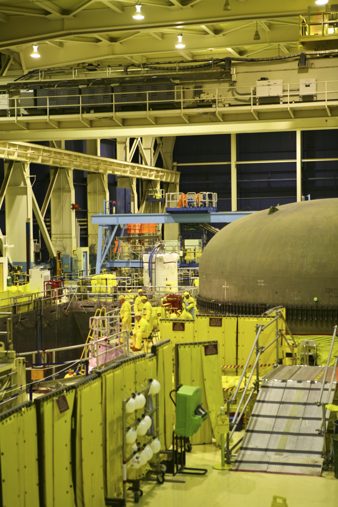 Enformable TVA workers carry out refueling operations on the Unit 2 reactor.-683