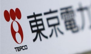 A TEPCO logo is pictured on a sign showing the way to the venue of the company&#039;s annual shareholders&#039; meeting in Tokyo