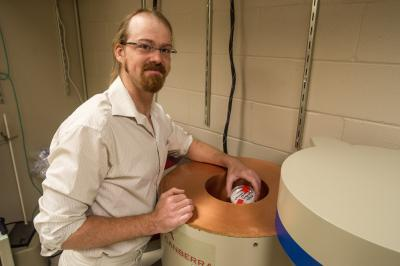 Dartmouth research associate Joshua Landis prepares to introduce a radioactive sample into a gamma-ray spectrometer.  Credit: Eli Burak