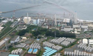 An aerial view shows TEPCO's tsunami-crippled Fukushima Daiichi nuclear power plant and its contaminated water storage tanks in Fukushima